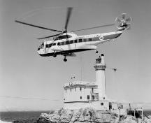 Historic photograph of Triple Islands Lighthouse, 1967.; Library and Archives Canada, Department of Transport | Bibliothèque et Archives Canada, Ministère des Transports, e008128980