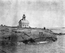 Historic photograph showing the Light tower; Jones Island Rear Range, ca. 1900.; Library and Archives Canada | Bibliothèque et Archives Canada, PA-148102