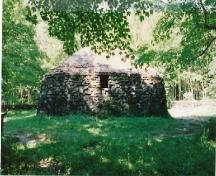 Side view of the Lone Shieling, showing a simple window, 1993.; Parks Canada Agency / Agence Parcs Canada, 1993.