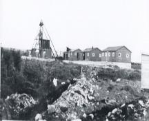 Iron Springs Mine Heritage Site showing the mine buildings and the shaft, also included is the building used as the temporary first aid center for the survivors of the Truxtun and Pollux ship wrecks. Photo ca 1942.; Ena Farrell Edwards 2005.