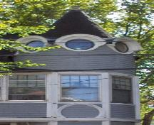 Showing detail of turret with roundel windows; City of Charlottetown, Natalie Munn, 2005