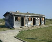 Vew northwest at reconstructed Men's House, 2004.; Government of Saskatchewan, Marvin Thomas, 2004.