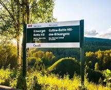 View of the Gitwangak Battle Hill and its sign; Parks Canada | Parcs Canada