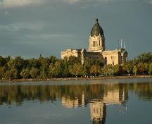 View of the Legislative Building and Grounds from across the lake which highlights the prominence of the dome on the local skyline; Government of Saskatchewan, Calvin Fehr, 2004.