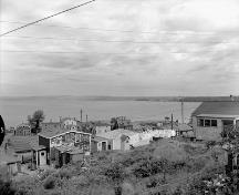 Aerial view of Africville prior to relocation, ca. 1958.; Library and Archives Canada | Bibliotheque et Archives Canada, C.M.H.C., PA-170741.