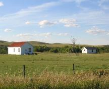 View northwest at park and reconstructed buildings (storehouse on left; barracks on right), 2004.; Government of Saskatchewan, Marvin Thomas, 2004.