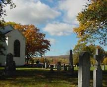 View of burial ground and rear elevation including chancel window, Old Holy Trinity Church, Middleton, 2005.; Courtesty of Old Holy Trinity Charitable Trust.