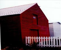 Exterior photo of Grant's Stage, Trinity, Trinity Bay, NL.  Photo showing water-facing side of building.; HFNL 2005