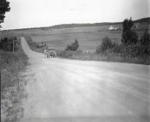 "This photo of a car coasting ""up"" Magnetic Hill appeared in the August 10, 1933 edition of the Telegraph-Journal newspaper in Saint John.  It represents the first widely published report and photos of this phenomenon.; Moncton Museum"