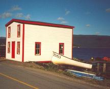 Exterior photo of landward and side facade of Roberts Store, showing Woody Point Harbour.; Town of Woody Point 2005