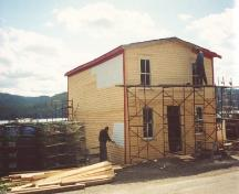 The restoration of Roberts Store in progreess in 2002 under the Fisheries Heritage Preservation Program of the Heritage Foundation of Newfoundland and Labrador.; HFNL 2005
