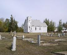 View of church and cemetery from the SW, 2003.; Government of Saskatchewan, Jennifer Bisson, 2003.