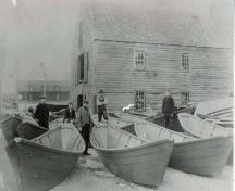 Workers posing with new dories outside of the Dory Shop, Shelburne, NS, ca. 1890.; Courtesy of the Shelburne County Museum.