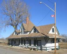 "Front and side facades of the station showing the roofline and ""Radville"" name set in the roof, 2005.; Government of Saskatchewan, Marvin Thomas, 2005."