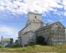 View northeast showing the elevator, annex and office, 2004.; Government of Saskatchewan, Marvin Thomas, 2004.
