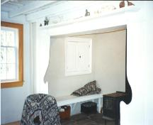 Interior view of central fireplace showing seating area, White House, Portugal Cove/ St. Philips, NL.; HFNL 2006