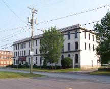 364 Argyle Street (former Palmer-McLellan Factory) western side view of building with former Hartt Boot and Shoe Factory in the background; City of Fredericton