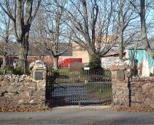Main entrance and rubble wall, Old Cemetery, Wolfville, 2005.   ; Heritage Division, NS Dept. of Tourism, Culture and Heritage, 2005